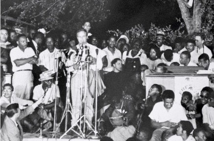 Marlon Brando and Martin Luther King speak to 5,000 civil rights activists in Jackson, Mississippi, 1966